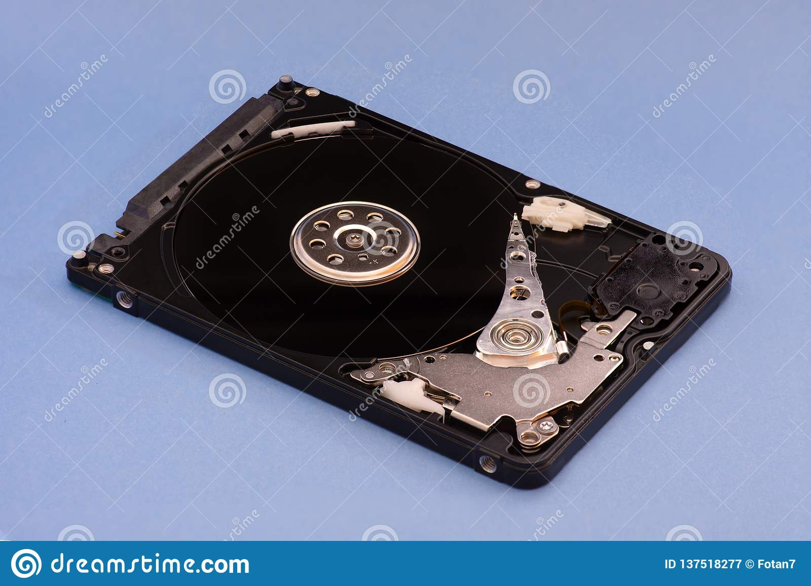 Opened disassembled hard drive from the computer, hdd with mirror effect. on blue background
