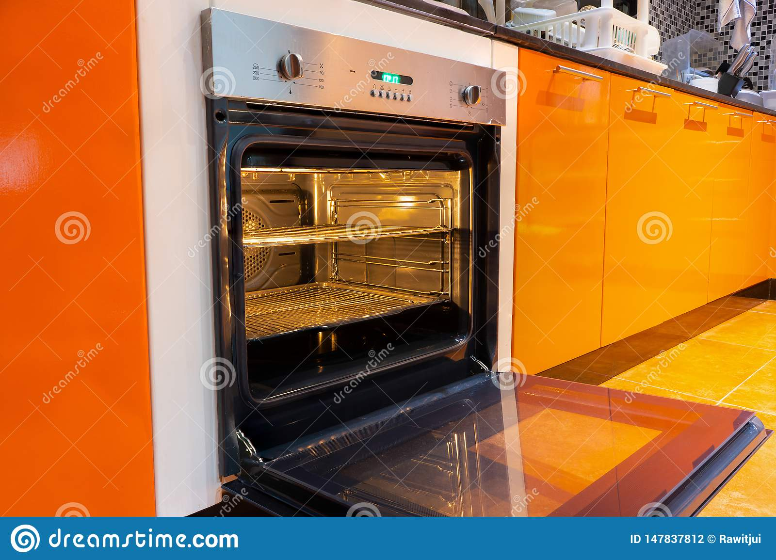 Opened oven in the kitchen