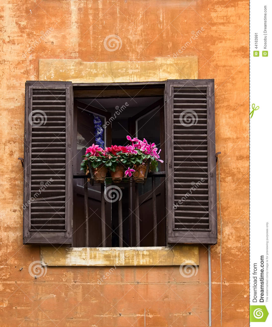Opened Window With Flower Pots On Facade In Rome Italy