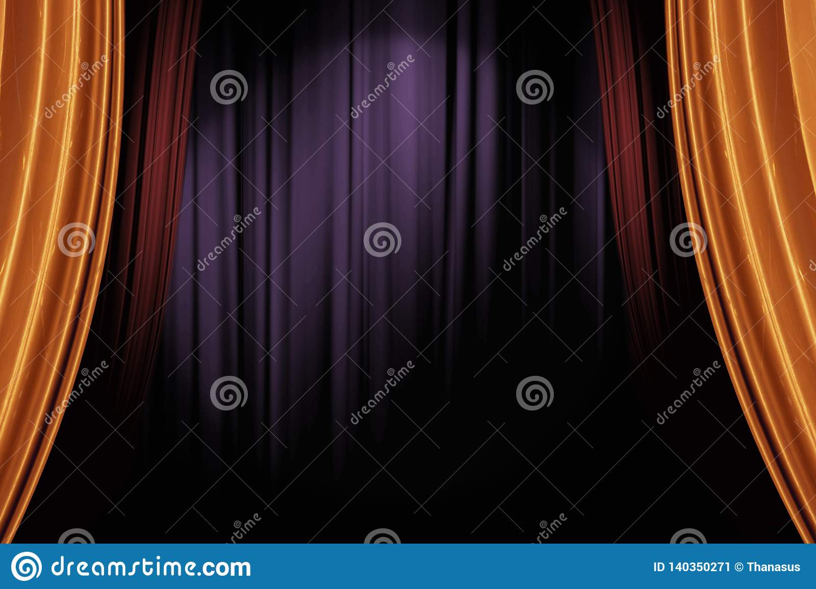 Gold and red stage curtains in dark theater for a live performance background