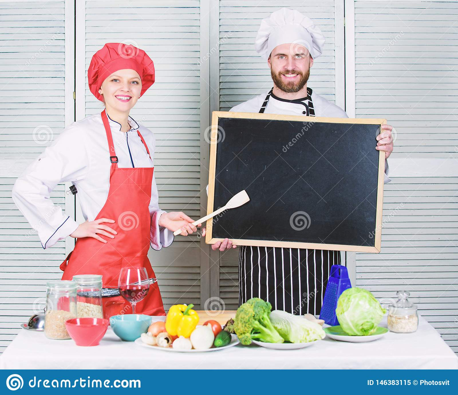 Opening soon. Hiring staff. Woman and man chef hold blackboard copy space. Job position. Cooking delicious meal recipe