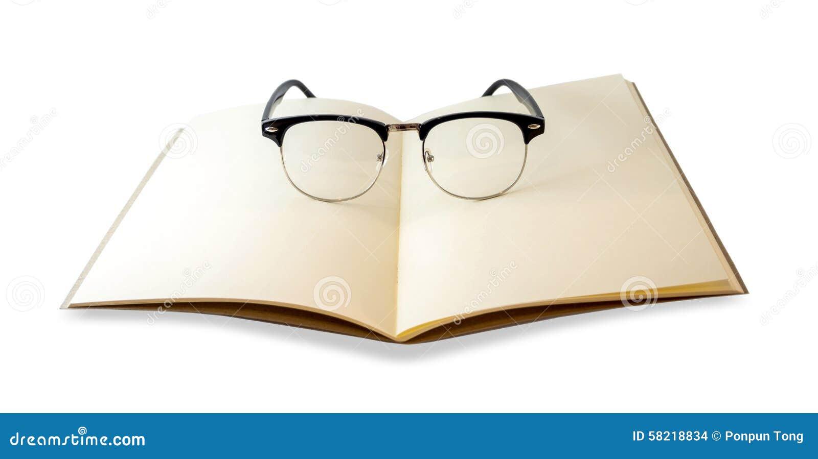 Openned brun anteckningsbok och isolerade ögonexponeringsglas