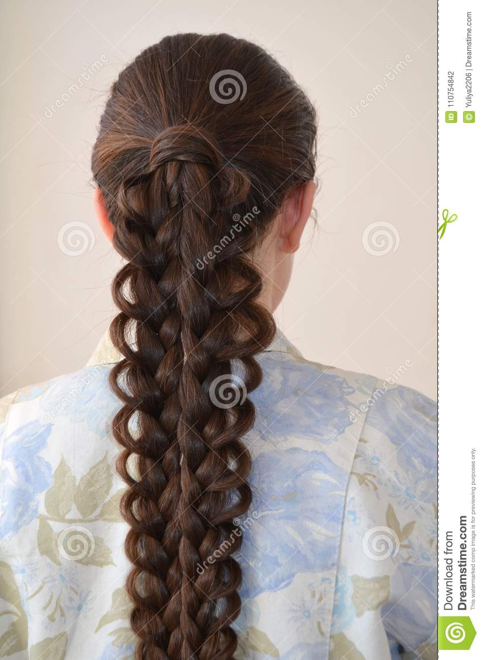 Openwork French Braid Hairstyle With Long Length Of Hair Stock