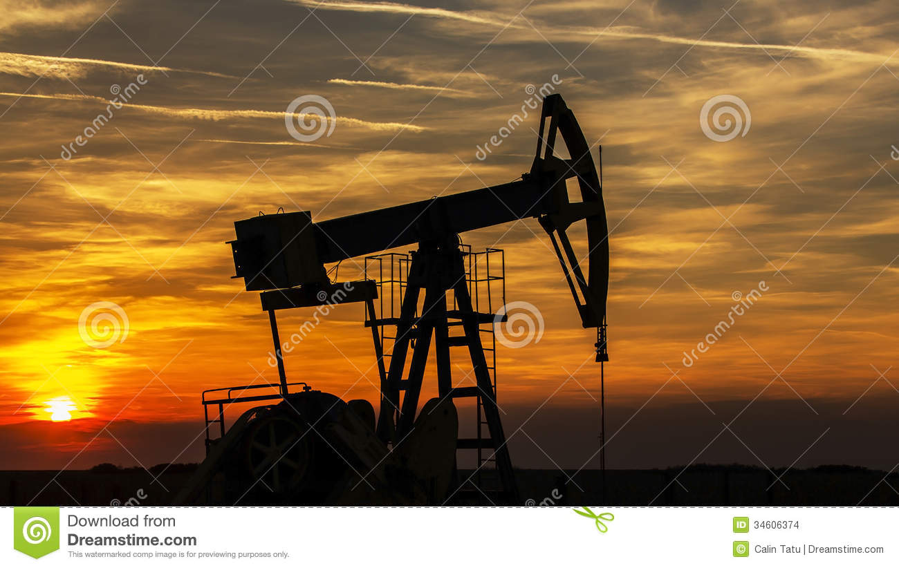 operating oil and gas well contour  outlined on sunset
