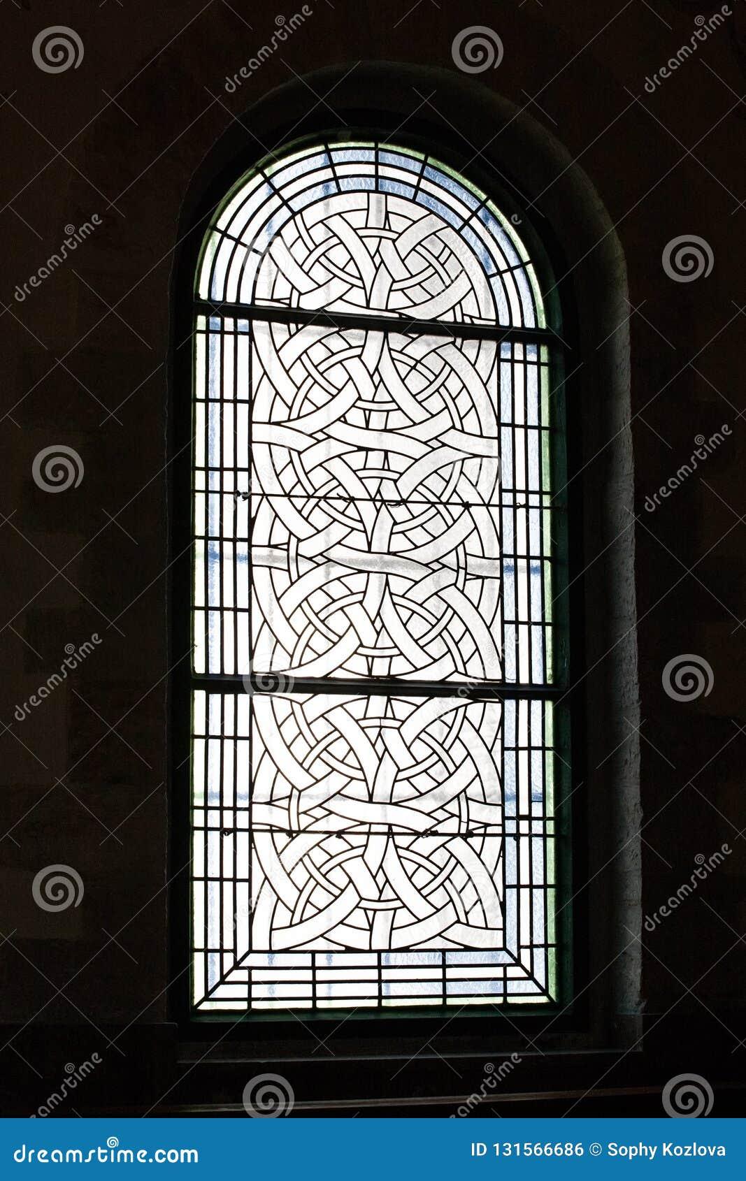 Opinião do detalhe do teste padrão do close up da janela de vidro colorido