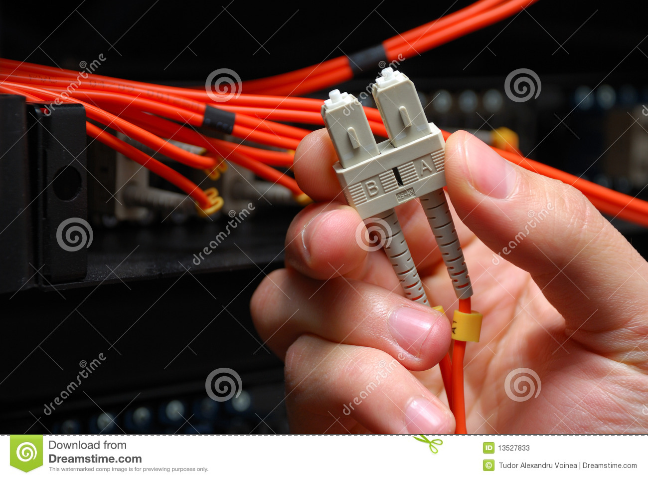Optical fiber high speed data cable held in hand