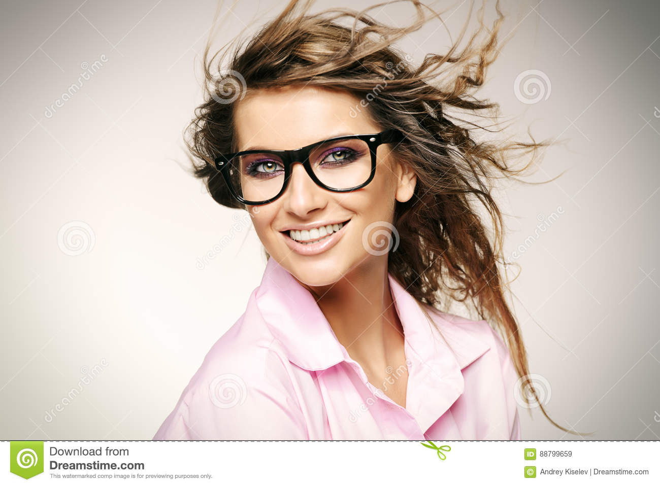 cd4b4f28c98 Close-up portrait of a gorgeous young woman wearing glasses. Beauty