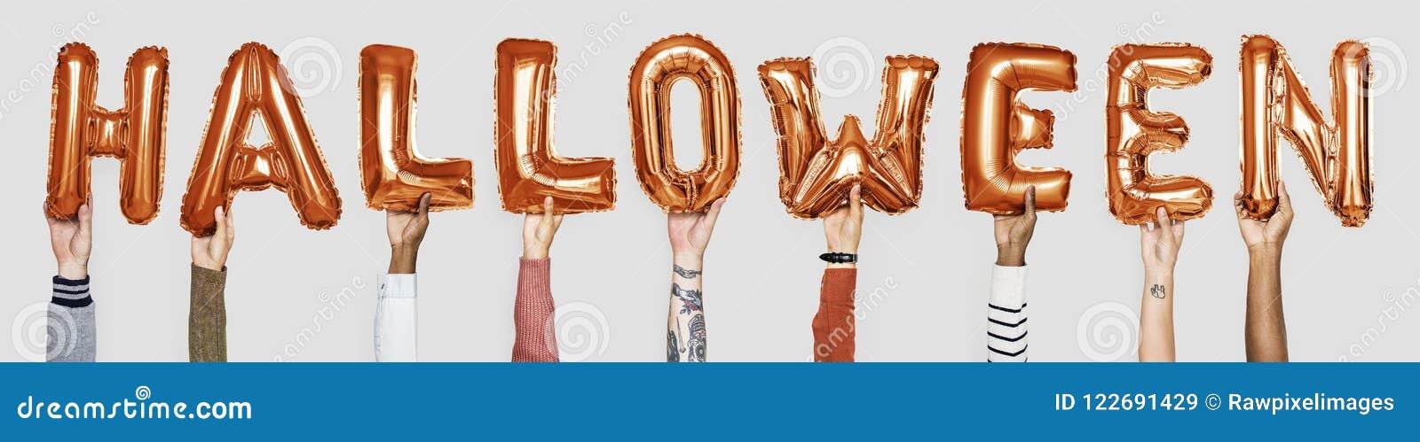 orange alphabet balloons forming the word halloween stock image