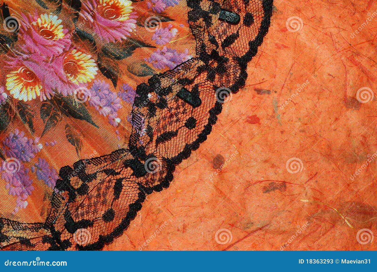 orange background with a spanish fan stock image