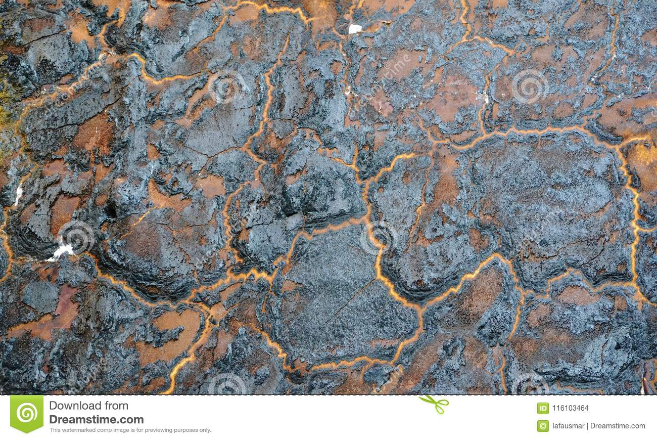 Burnt wall. Insulation foam charred on party wall. Orange and black abstract background
