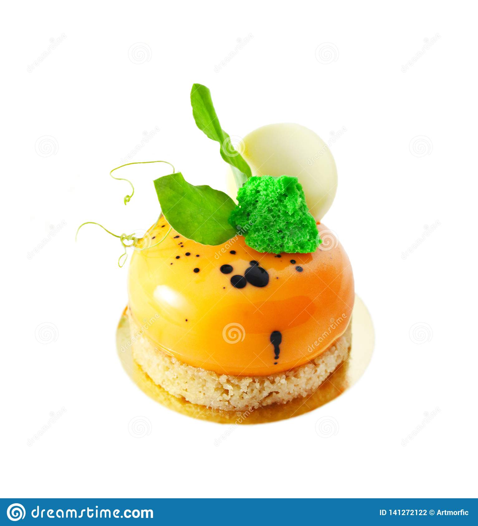 Orange carrot cake dessert with green leaves and white chocolate