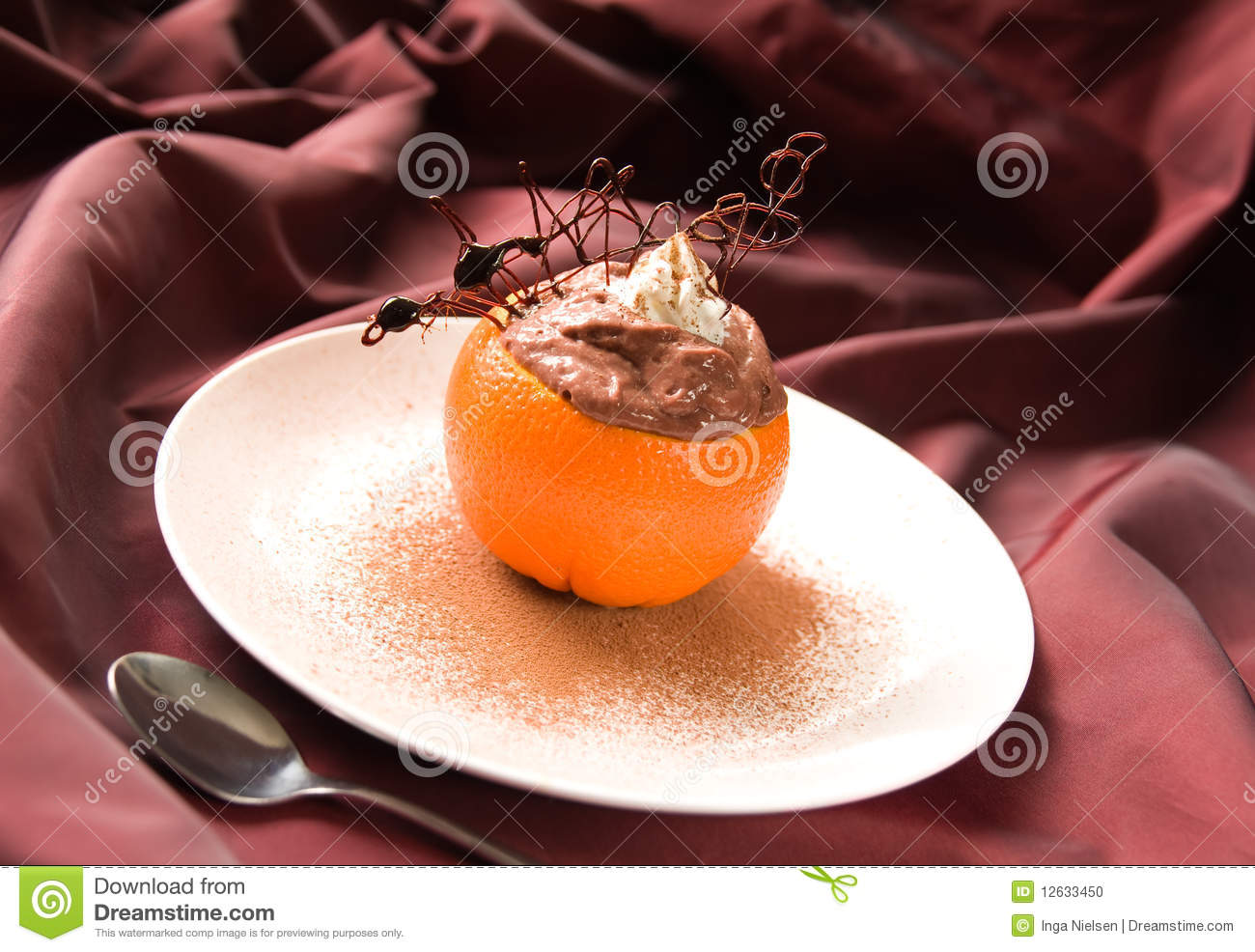 chocolate pudding or mousse au chocolate dessert in an open orange ...