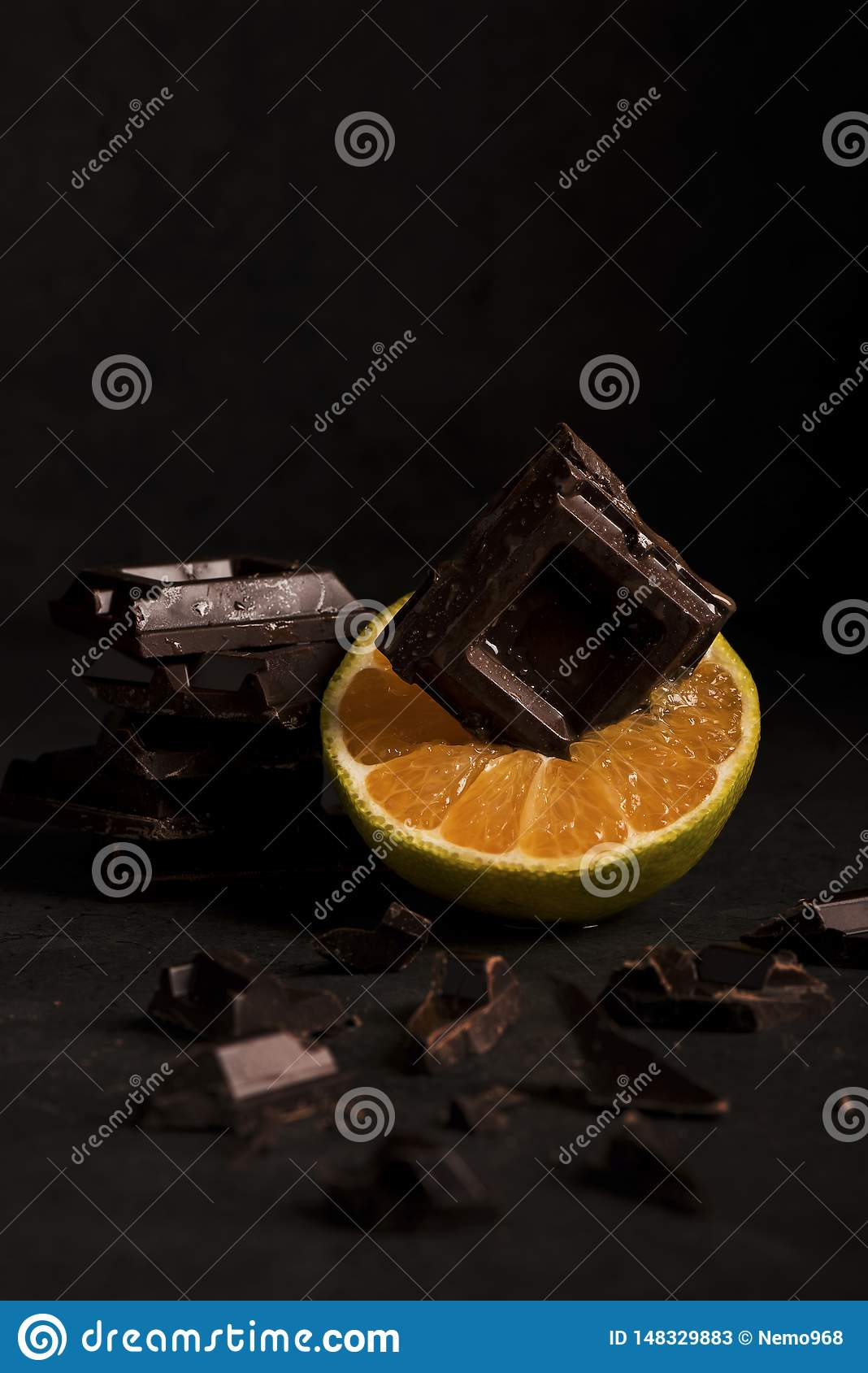 Orange with chocolate on wooden background