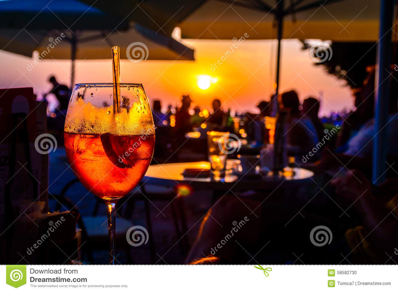 Orange cocktail in a beach bar at the sunset