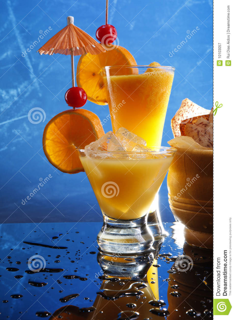Orange cocktails on blue royalty free stock photography for Orange and blue cocktails
