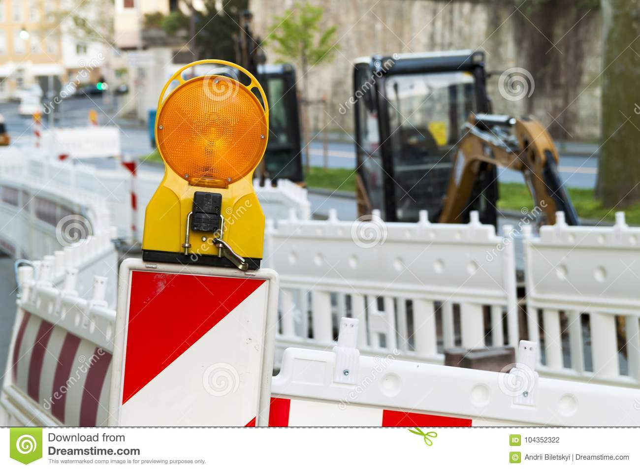 Orange construction Street barrier light on barricade. Road cons