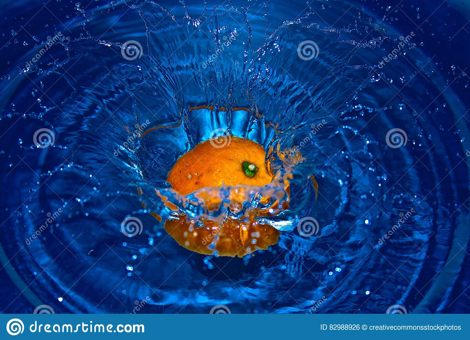 Orange Drop in Water in Time Laps Photography