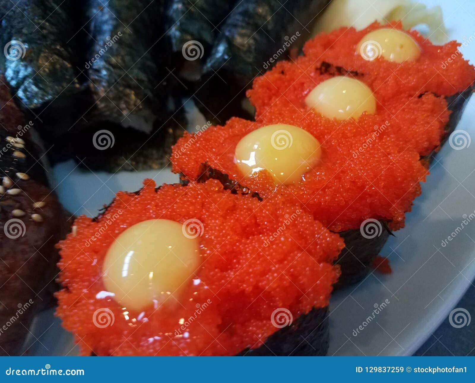 Orange Fish Eggs With Seaweed And Yellow Quail Egg Stock