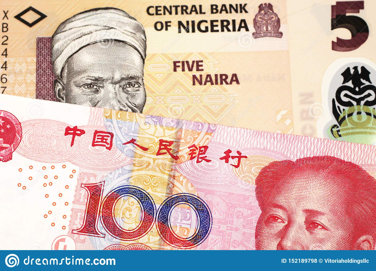 A Nigerian naira bill with with a Chinese yuan bank note close up