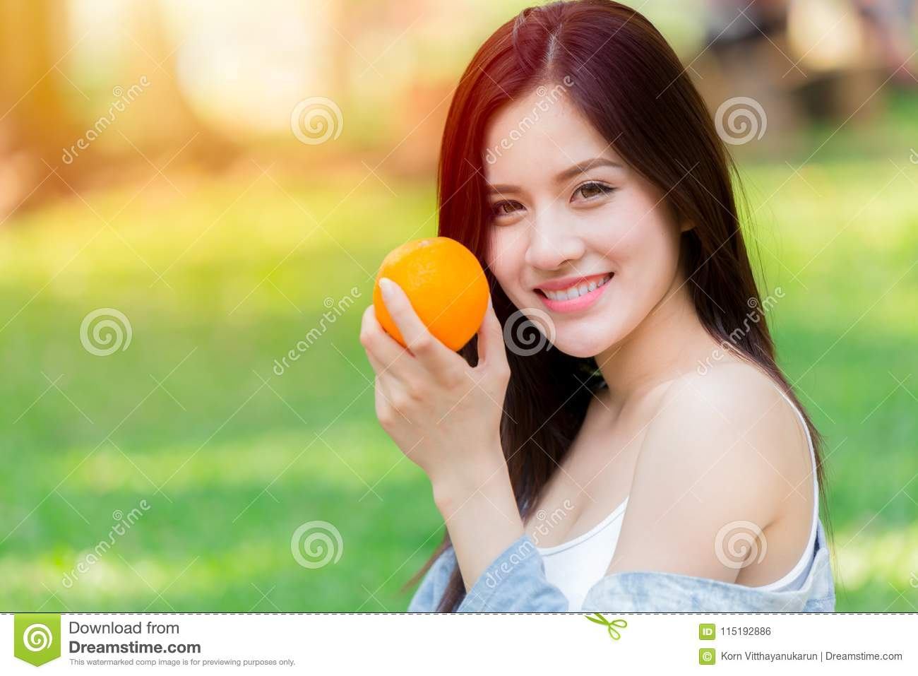 Orange Fruit with Healthy Asian woman high vitamin C