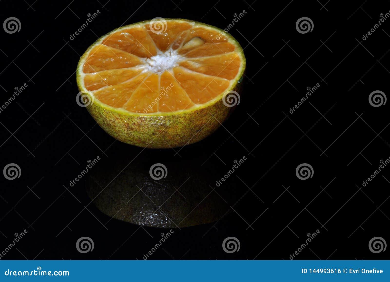 Orange fruit isolated  on black background. Fresh and healthy