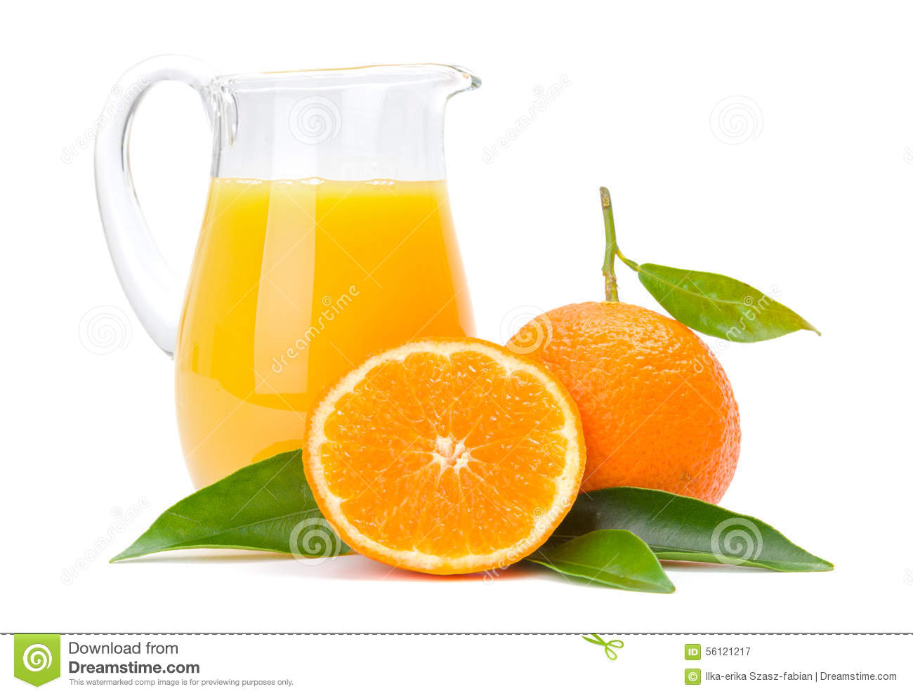 Orange fruits and jug of juice