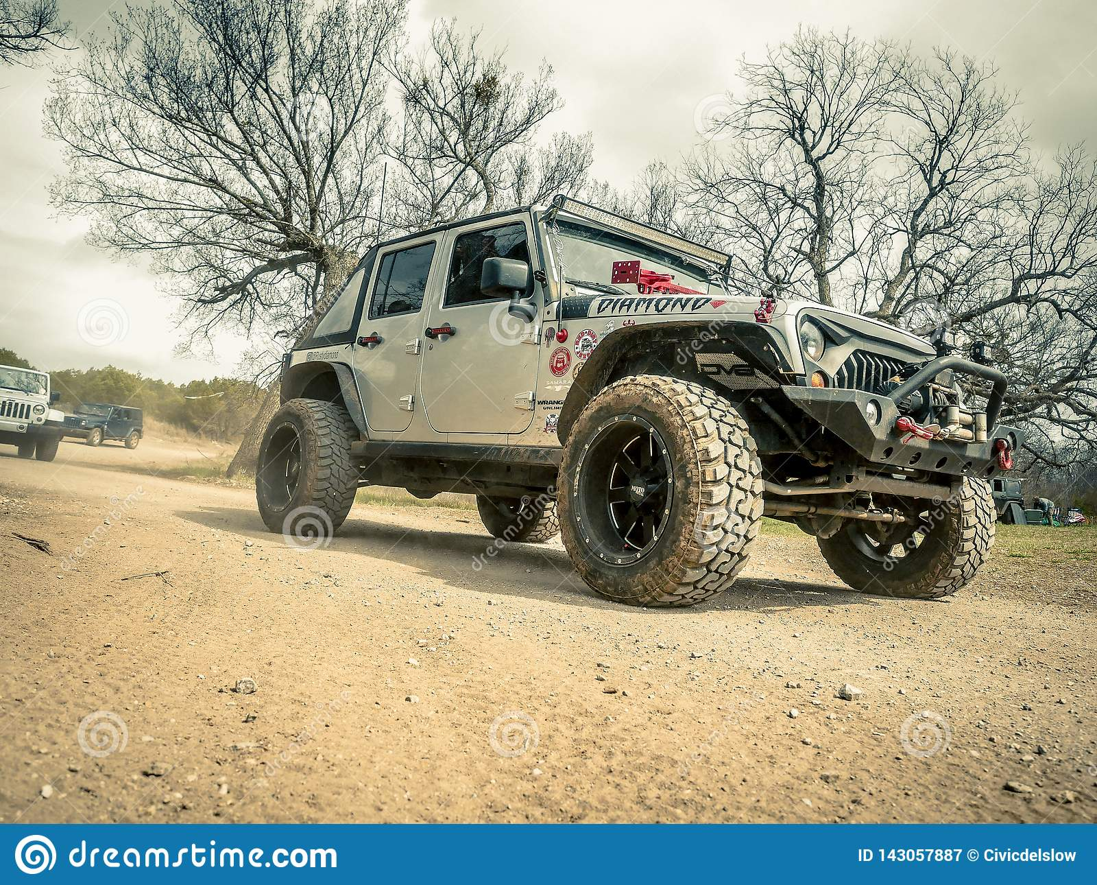 Orange Jeep Rock Crawling