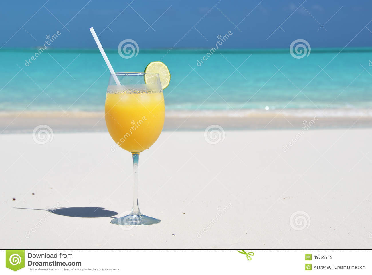 Orange juice on the beach