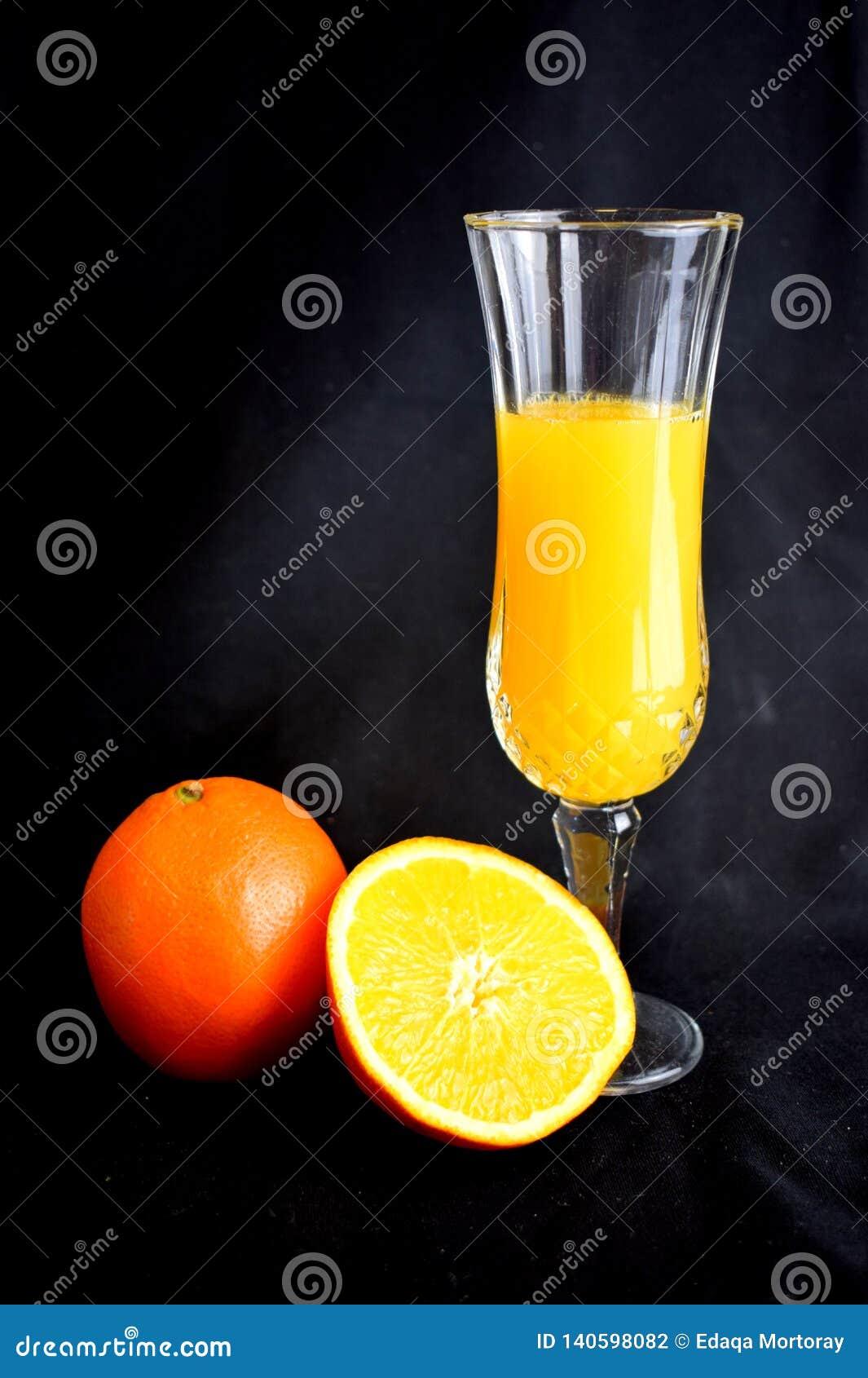 Orange juice in flute with cut orange