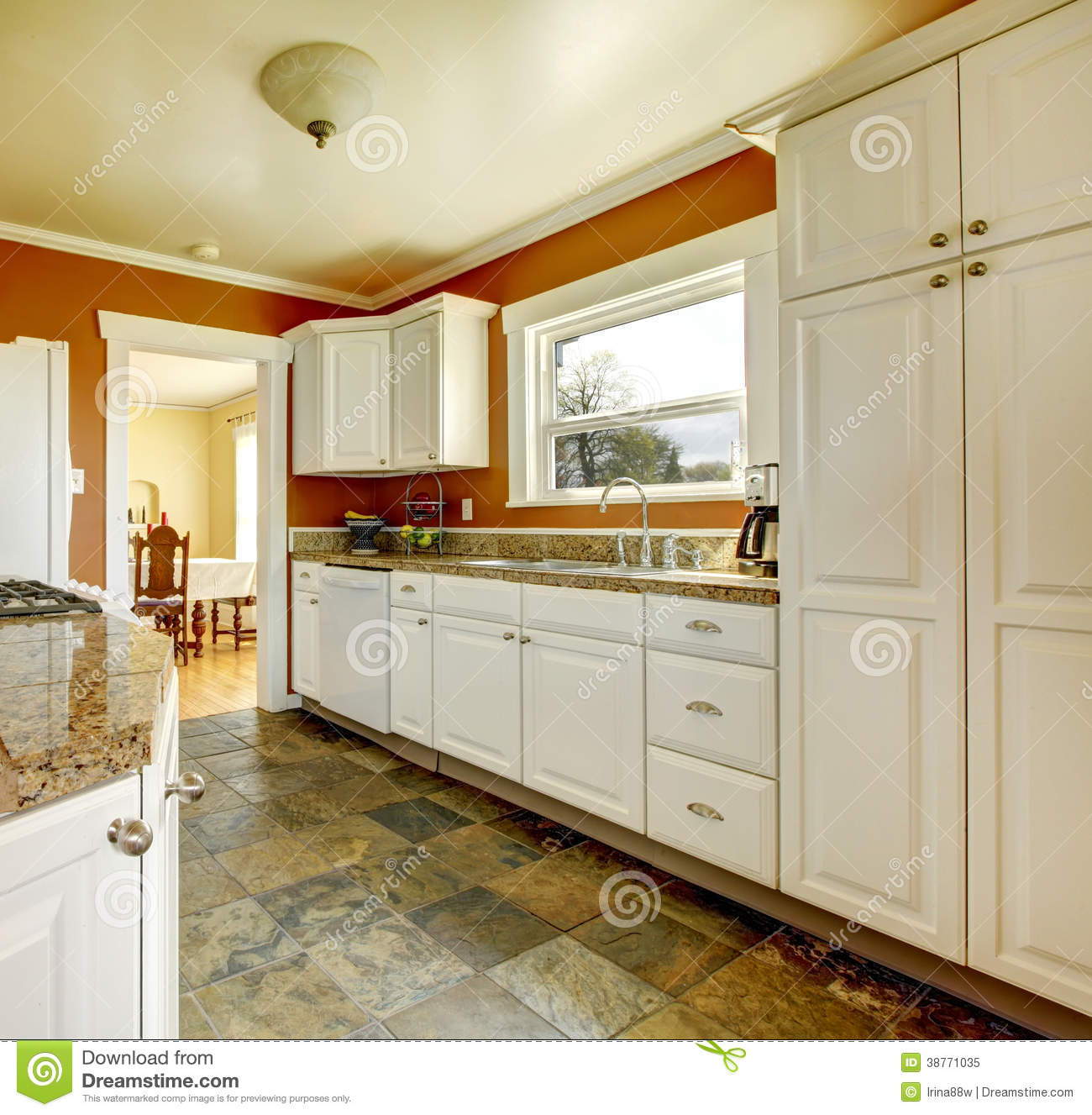 Orange kitchen room with white cabinets stock image for Kitchen walls with white cabinets