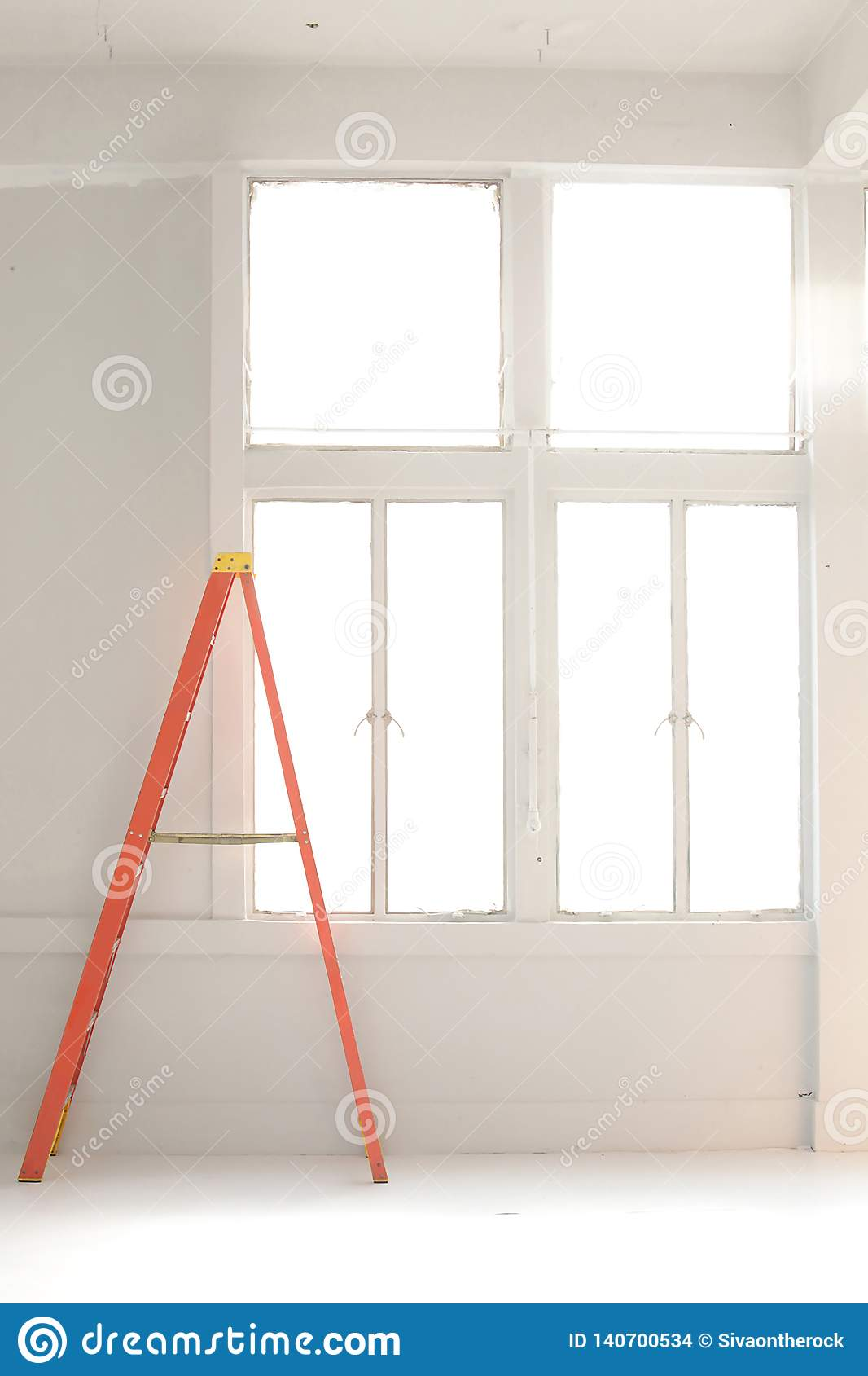 Orange ladder by the white wall