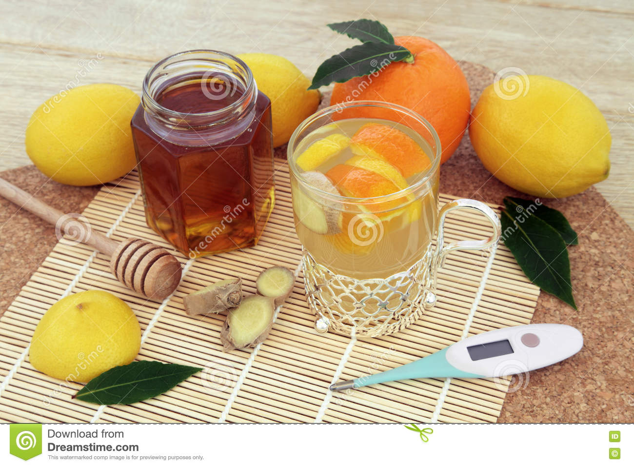 Orange, lemon and honey drink with ginger spice and fresh fruit and ...
