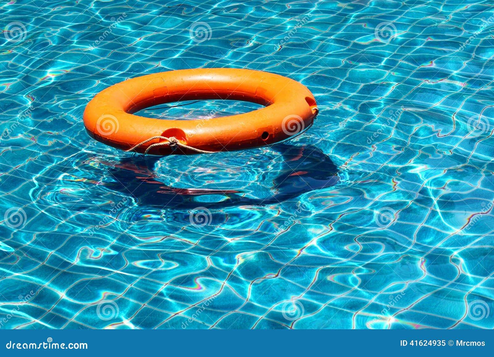 Orange Life Buoy Floating On The Surface Of Blue Water
