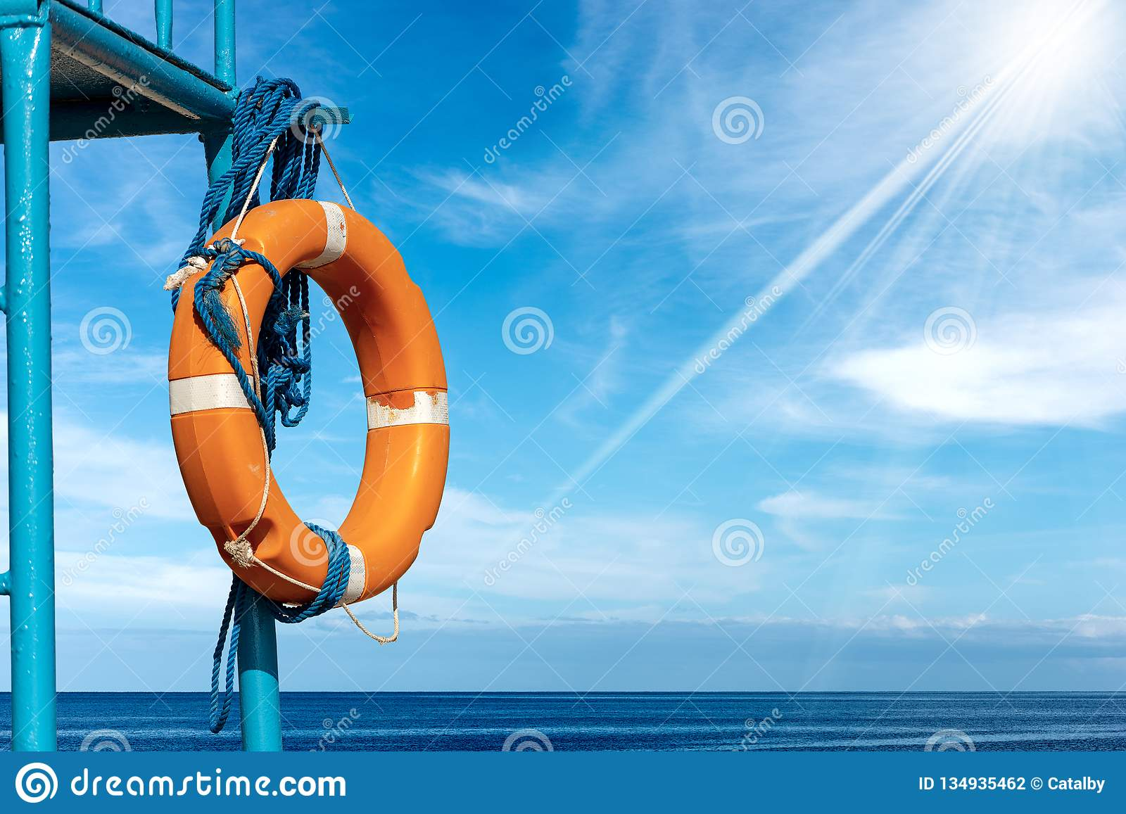 Orange Lifebuoy with Ropes on Lifeguard Chair