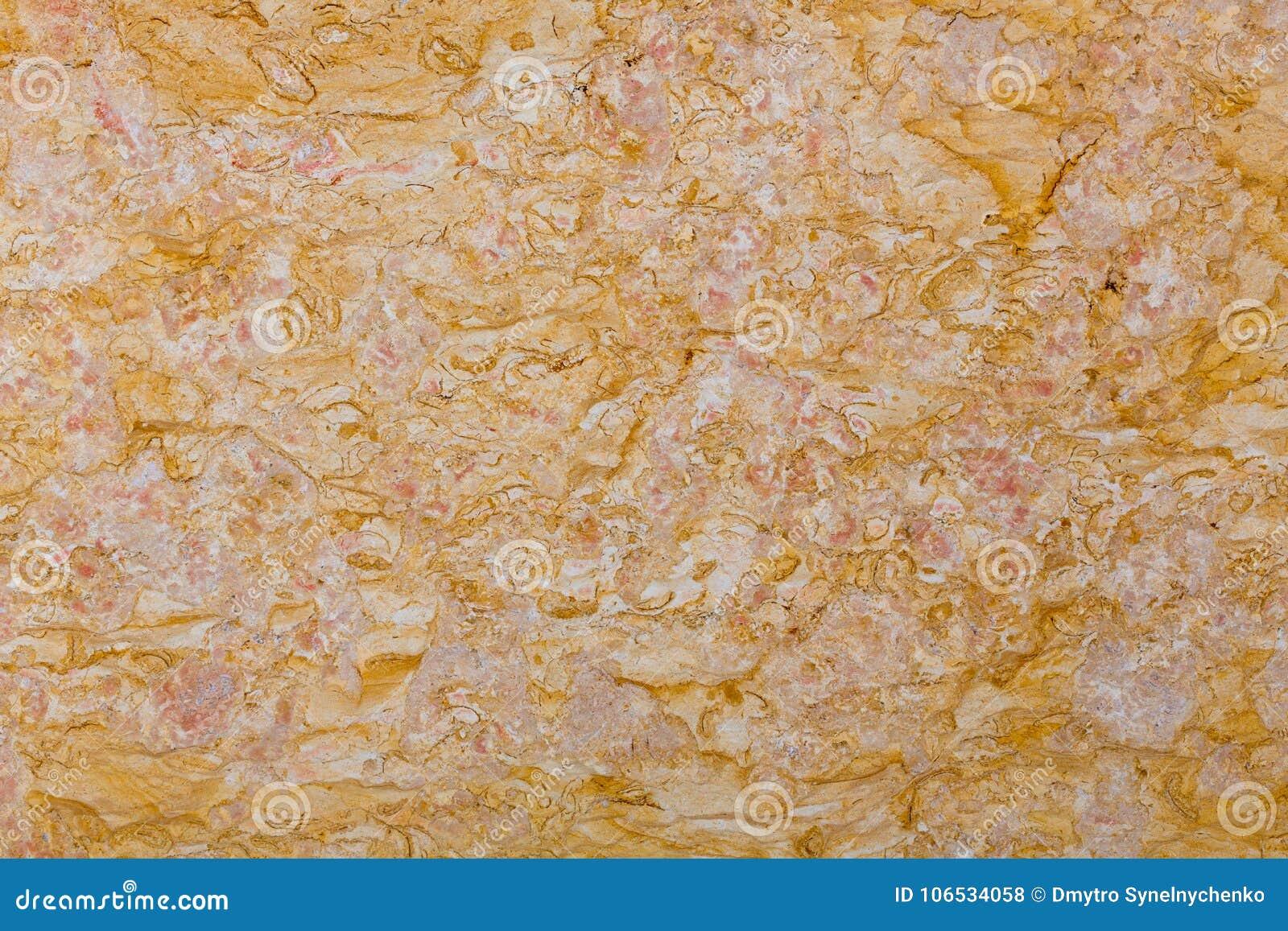 Orange marmortegelplattor texturerar väggen, abstrakt bakgrund