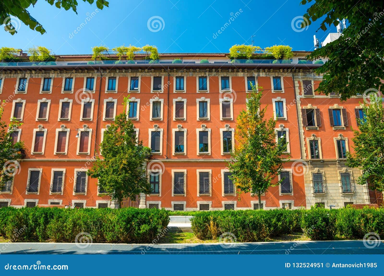 Orange Multi Storey Buildings With Rows Of Windows Milan