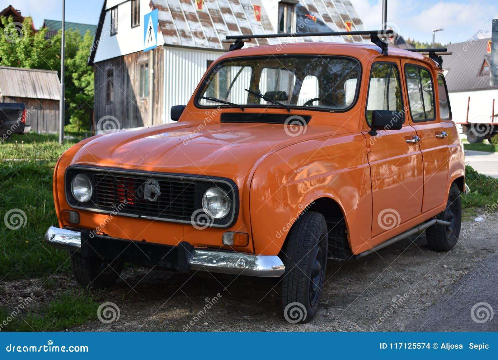 The orange old model of Renault four