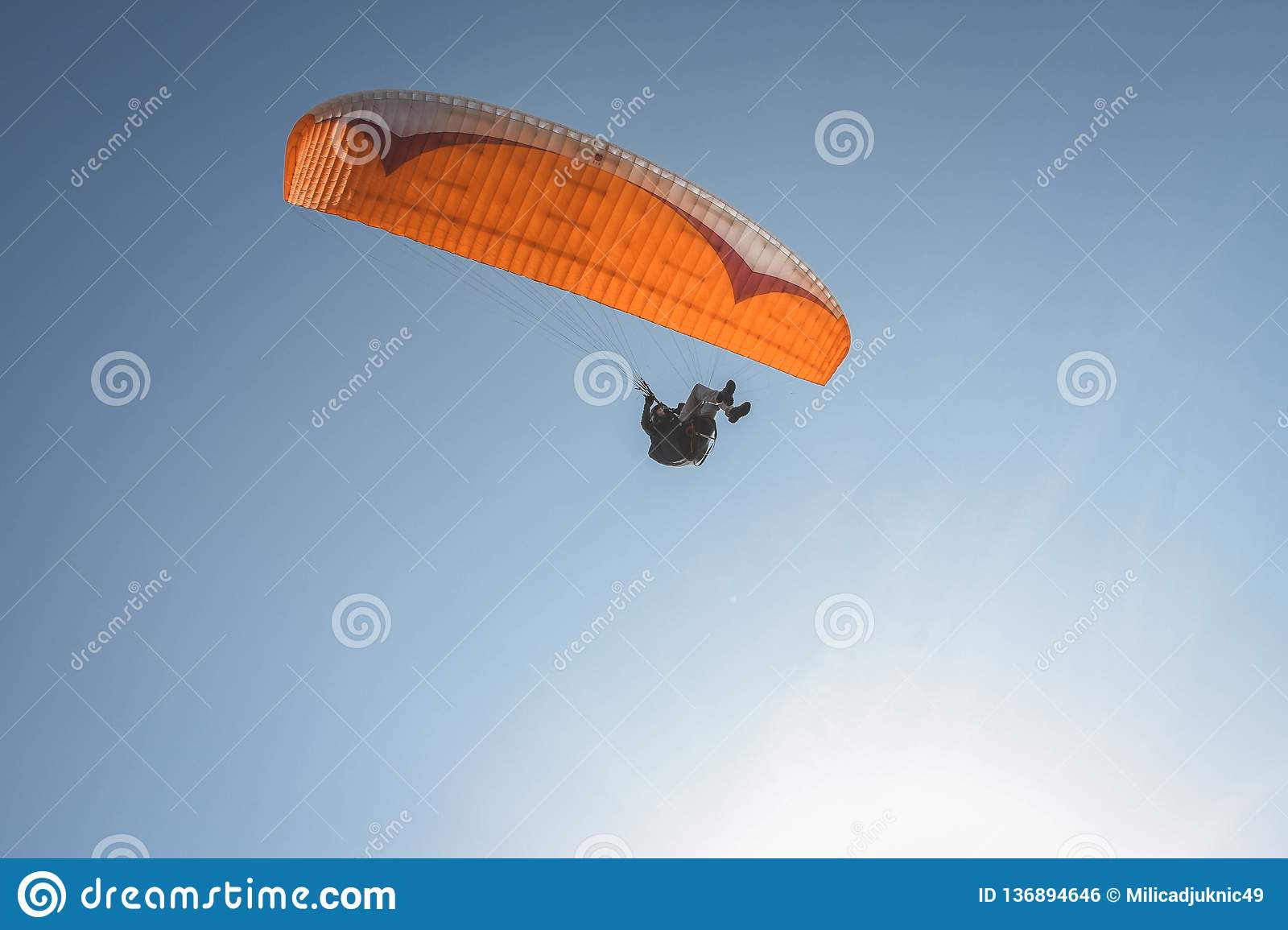 Orange Paraglider In The Blue Sky Editorial Photo - Image of sunny