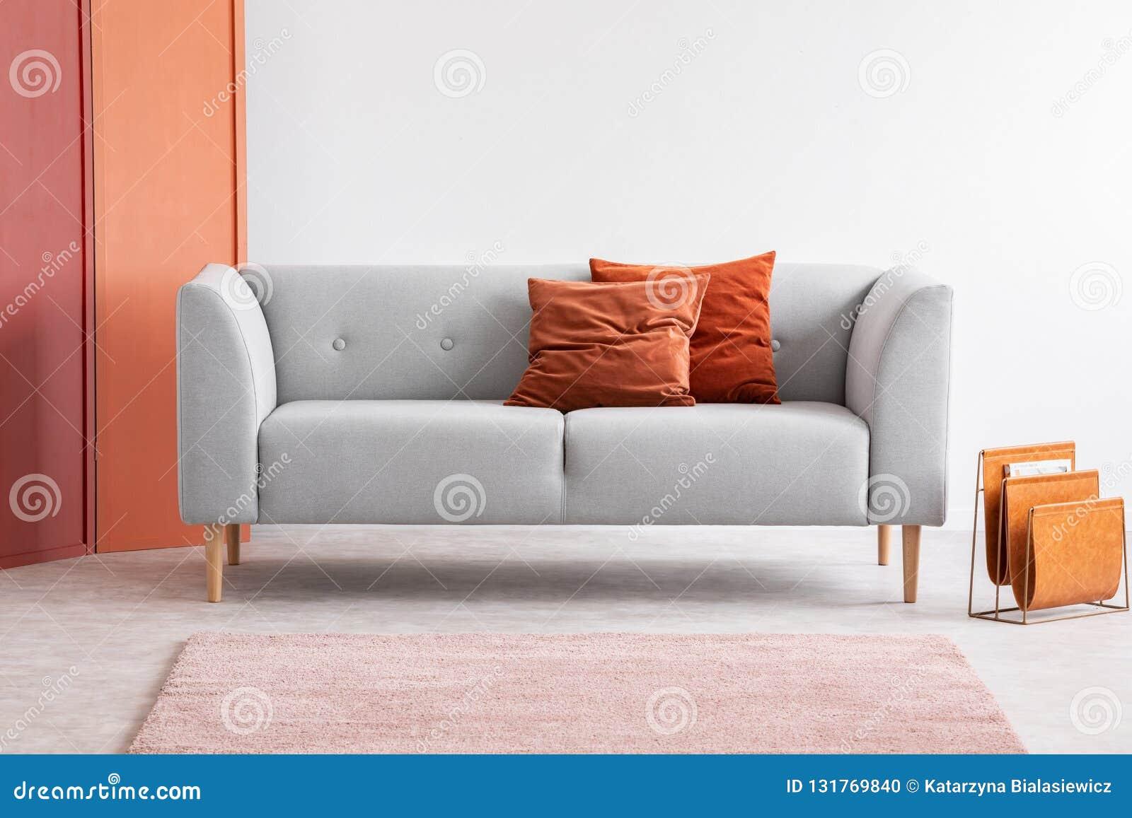 Orange Pillows On Grey Sofa In Grey Living Room Interior ...