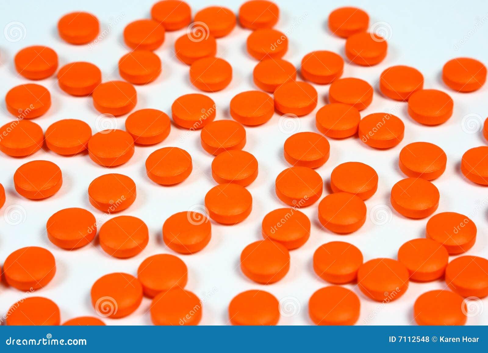 Orange pills background