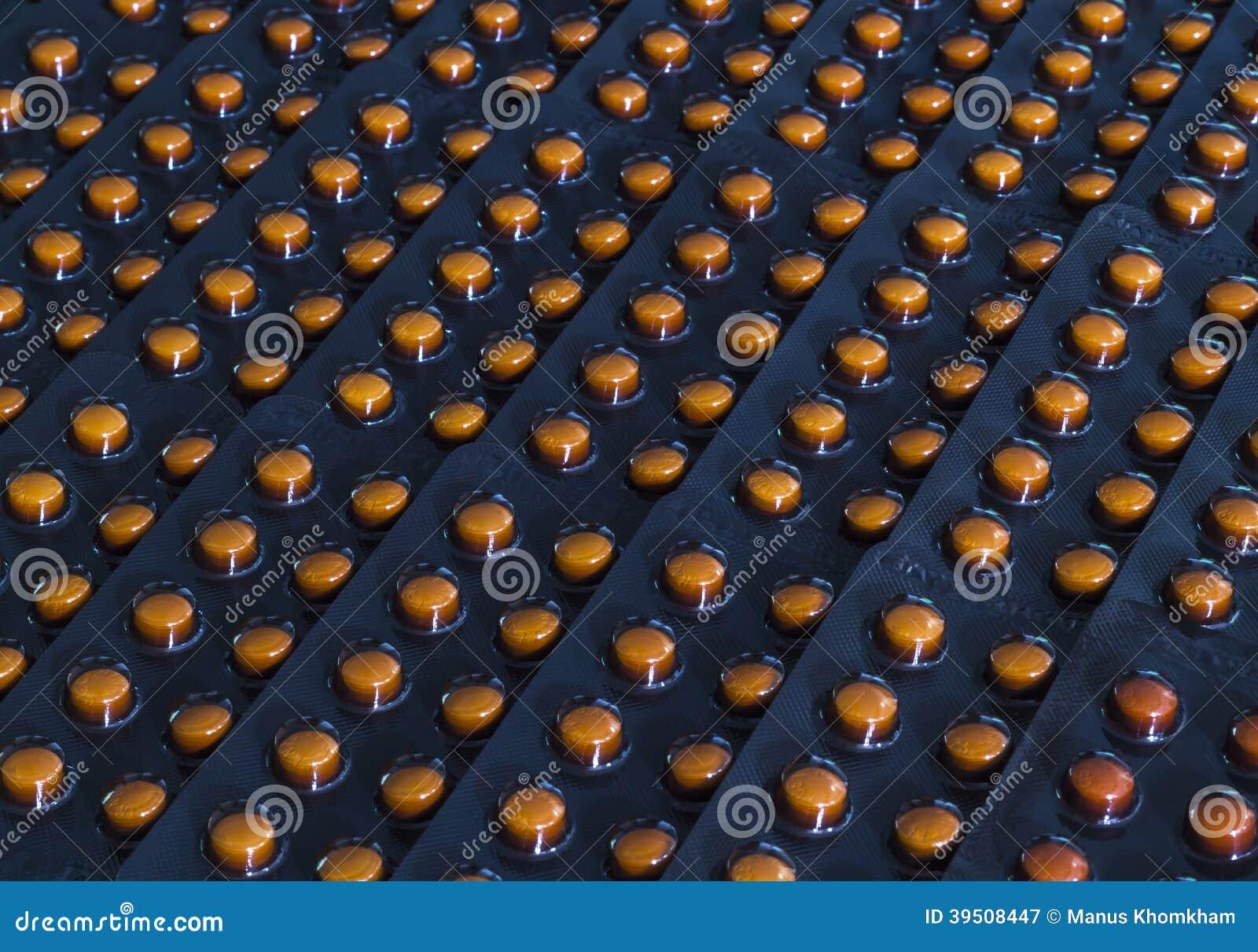 Orange pills in black blister pack