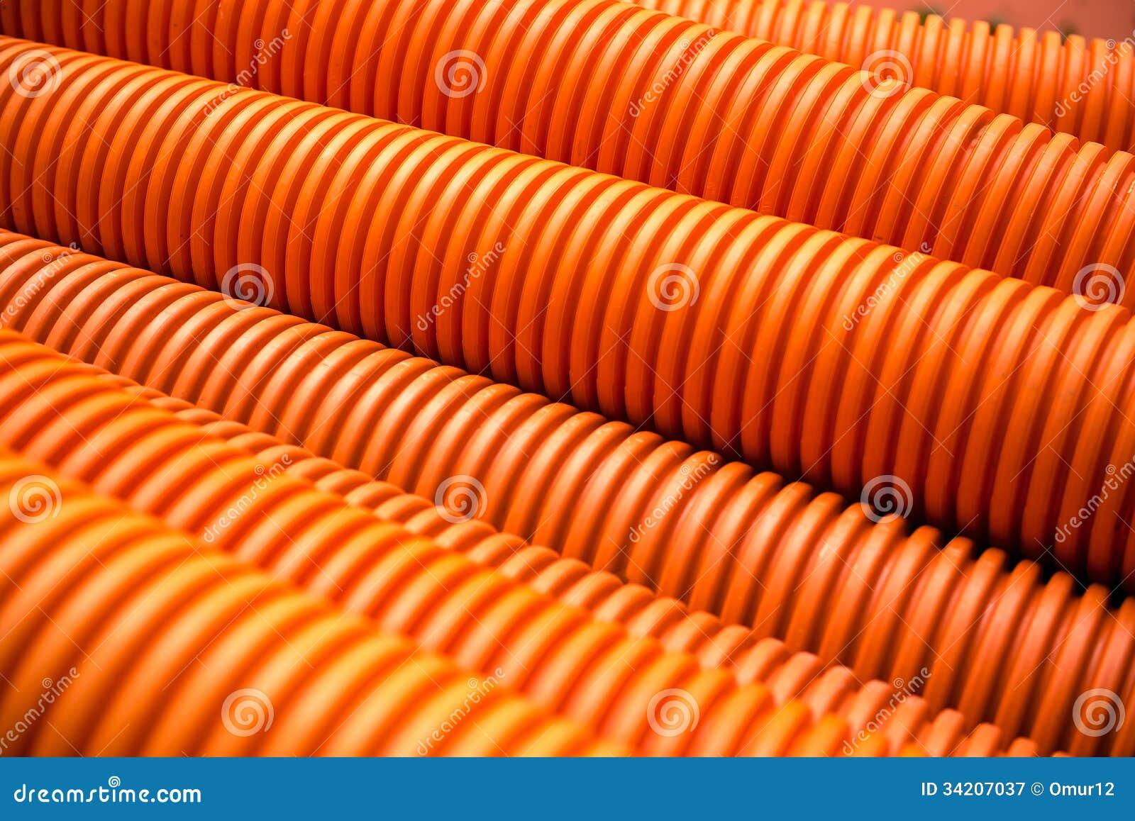 orange plastik pvc rohre auf industriellem stockbild bild 34207037. Black Bedroom Furniture Sets. Home Design Ideas