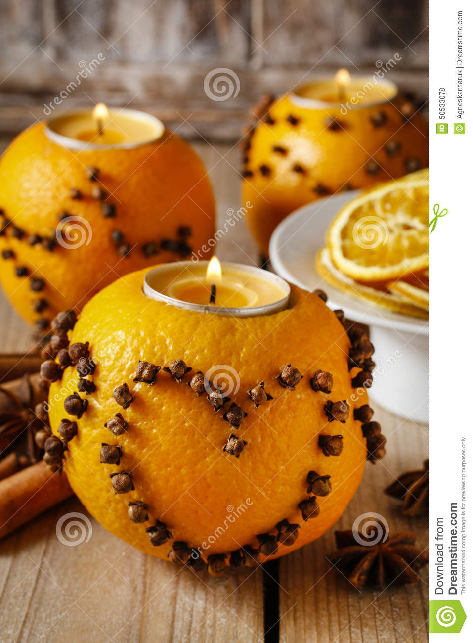 Orange Pomander Ball With Candle Decorated With Cloves In