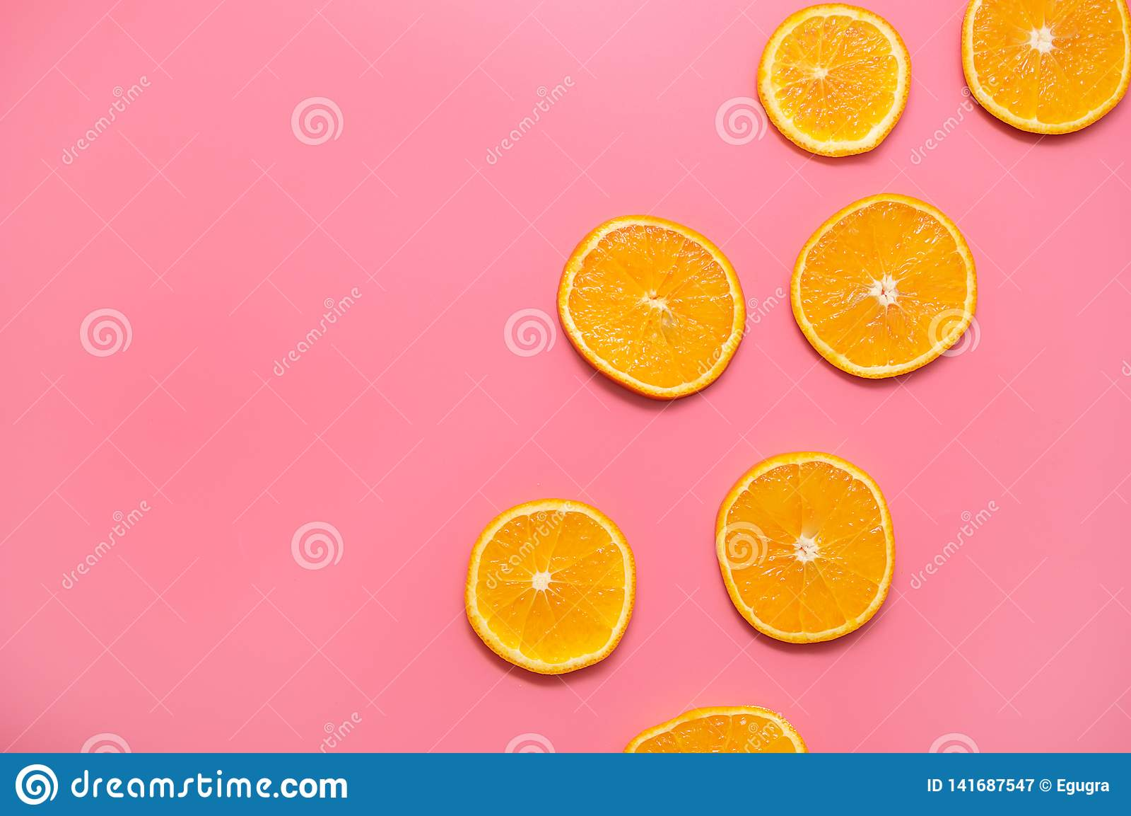 Orange slices on a pink background. fresh orange slices fruit pattern on pink background