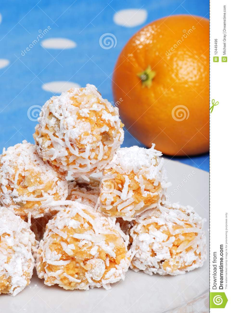 Orange Snowball Cookies With Fruit In The Backgrou Stock Photo