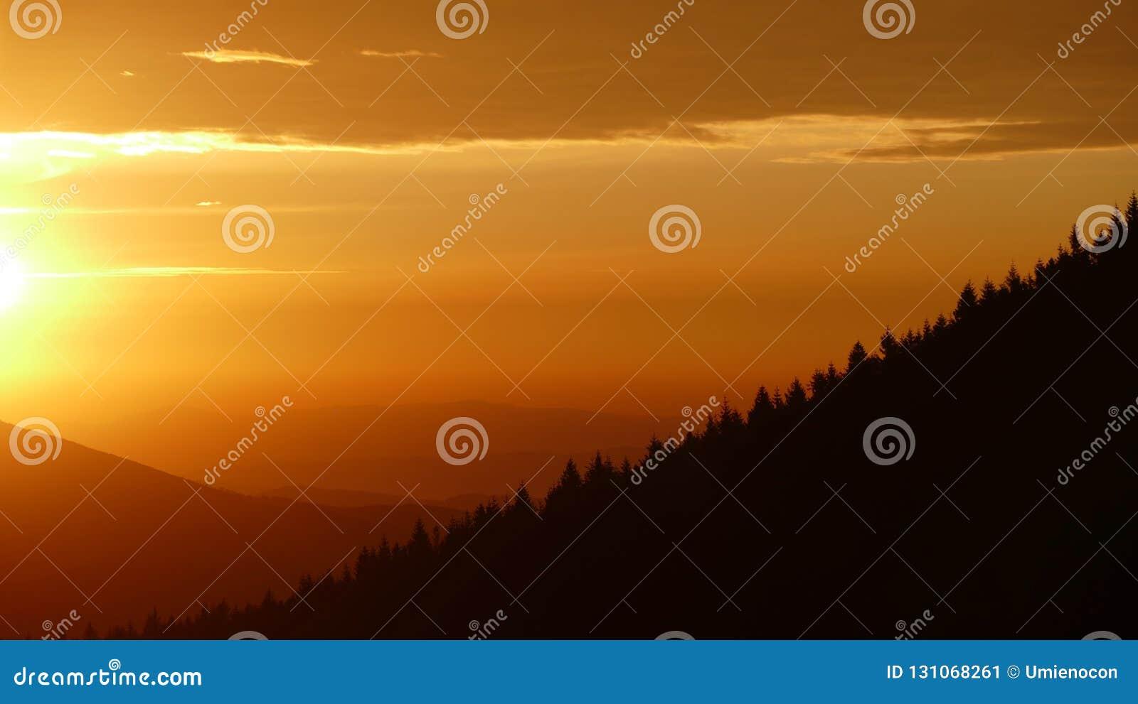 Orange sunrise. Before it finally arises, it shines briefly in orange.