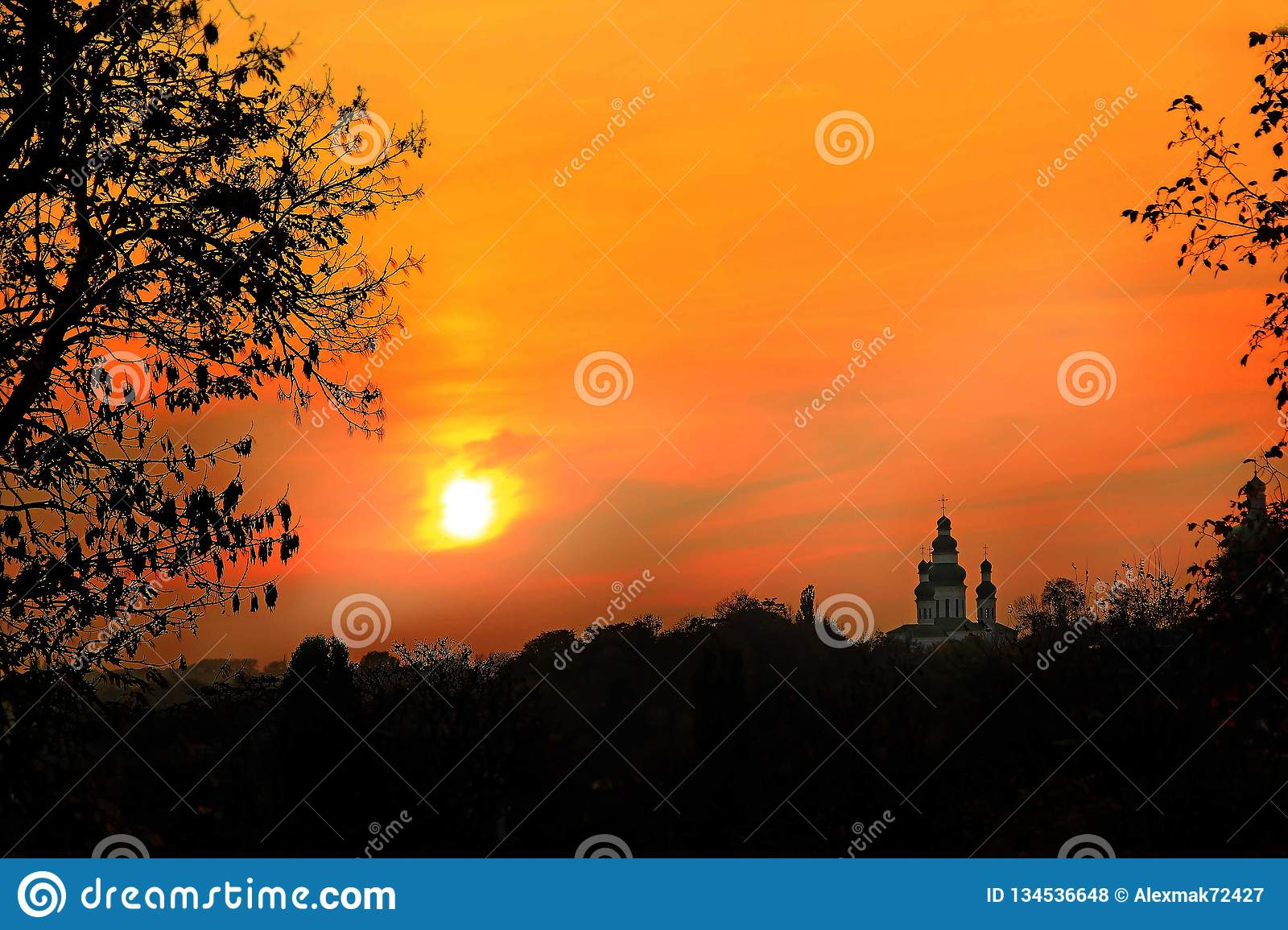 Orange sunset with beautiful evening landscape. Twilight with bright sunset.