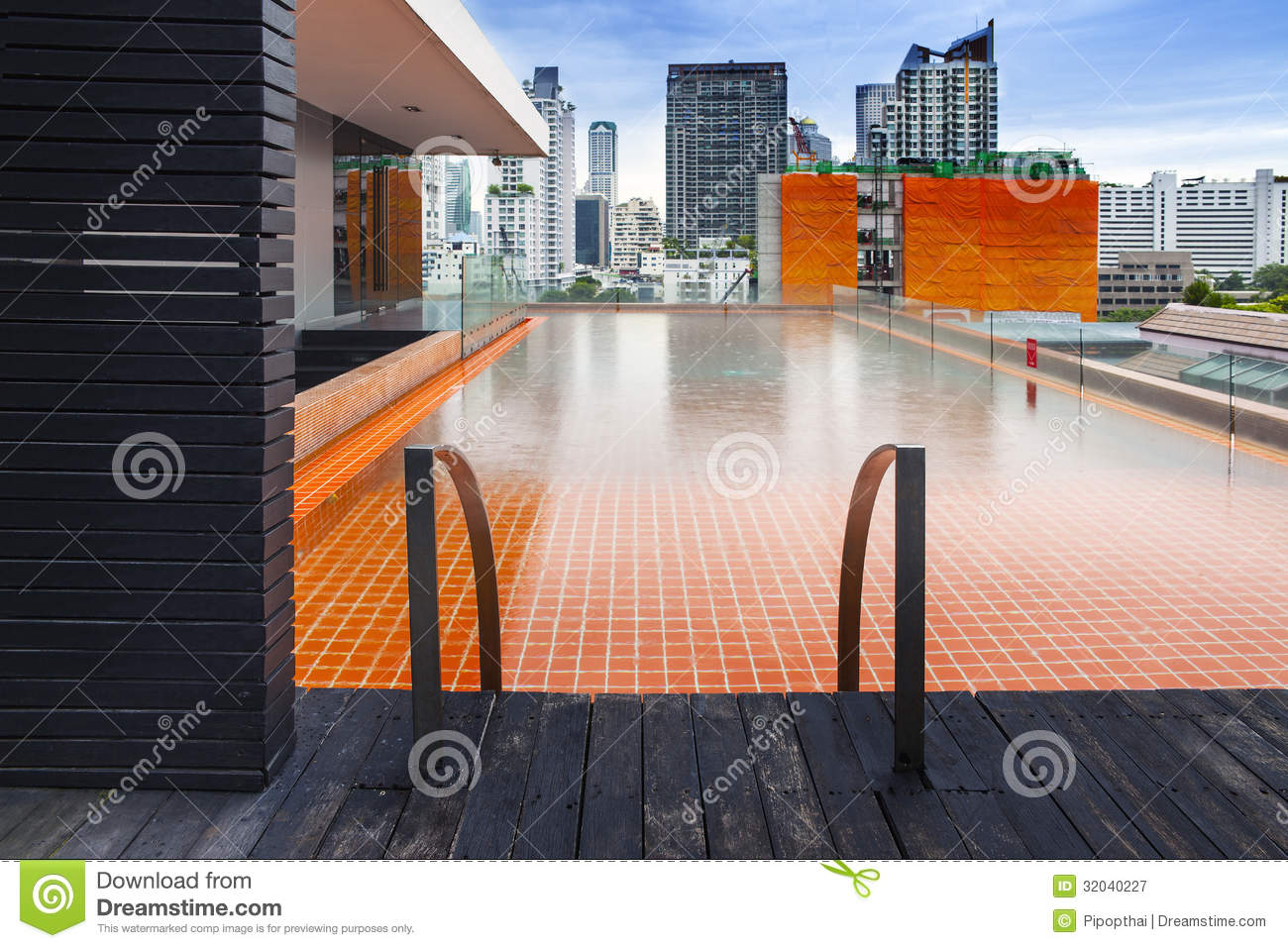 orange swimming pool on rooftop with modern buildi stock image image of business hotel 32040227