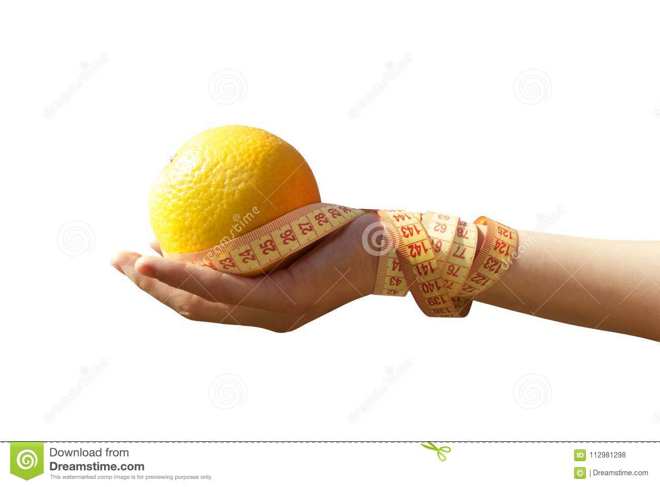 Orange and tape measure in hand on a white background