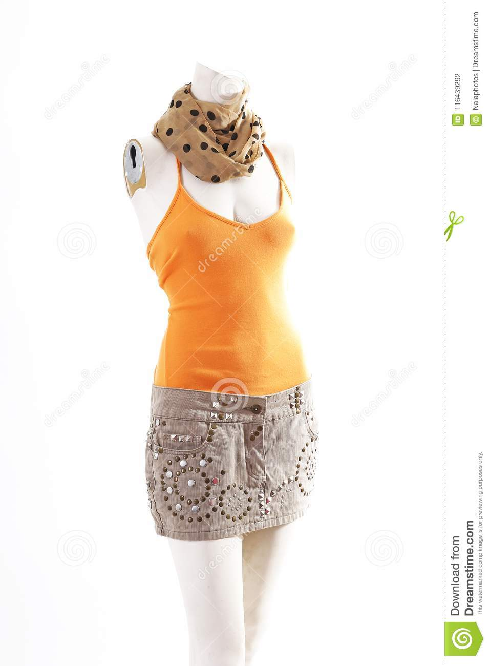 28082b721e3 Orange top and beige mini skirt on mannequin full body shop display. Woman  fashion styles